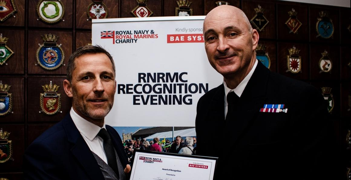 Richard Holmes, Chief Executive at Kings Camp, presenting Warrant Officer Class 1 Paul Nash RN with an award for his huge involvement with the project