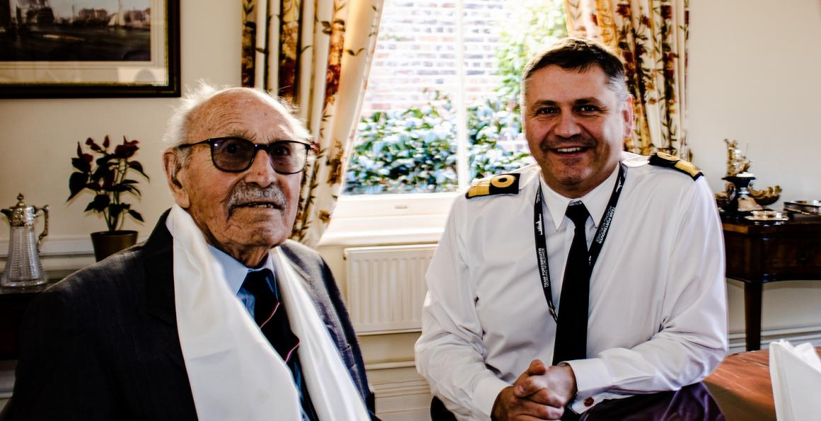 WW2 veteran Roy Harland with Portsmouth Naval Base Commander, Cdre Jeremy Bailey.