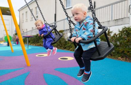 Children playing on swings at new Drumfork Children's Playpark